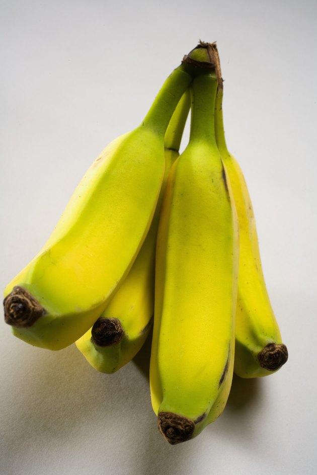 Studio shot of a bunch of bananas.