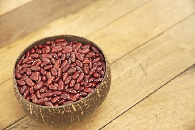Kidney beans over wooden board background