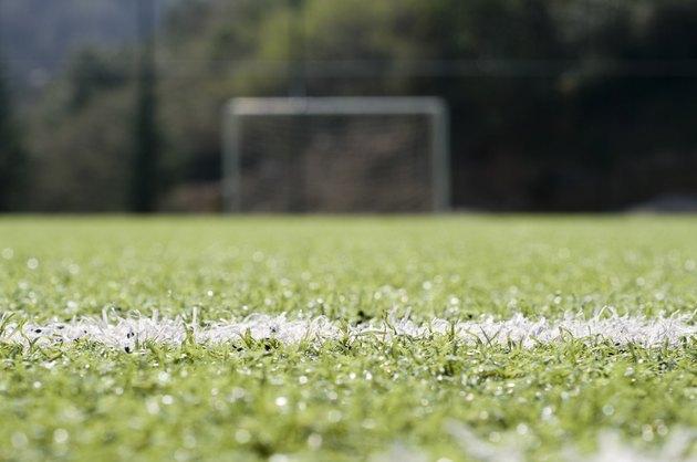 Football goal post on empty pitch, Turkey, Istanbul