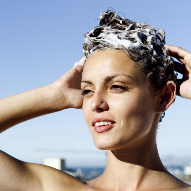 portrait of a woman shampooing her hair