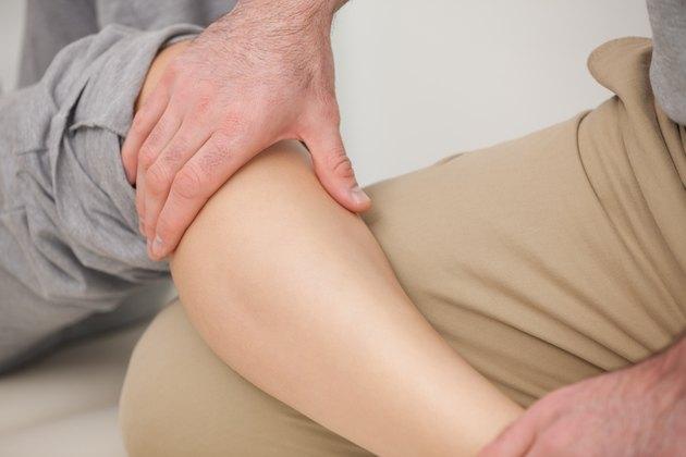 Man massaging the calves of a woman