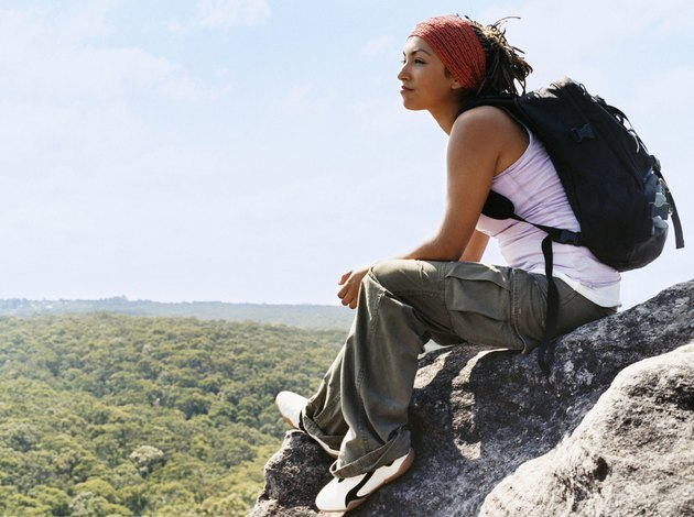 Woman Sitting on Rock Looking at View