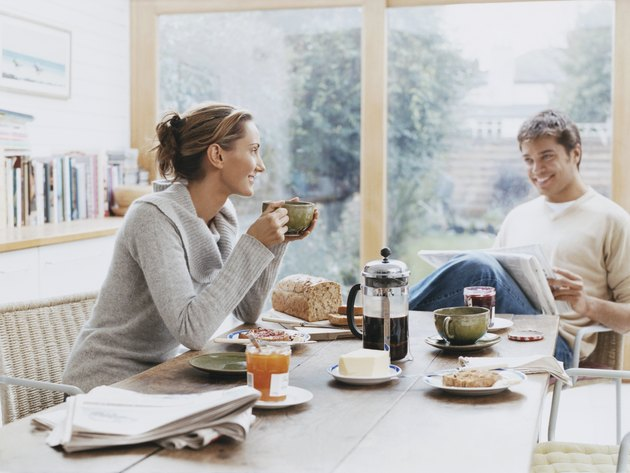 Couple Sits at a Table Over Breakfast