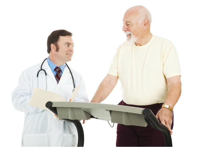 Fit Senior Man Consults Doctor