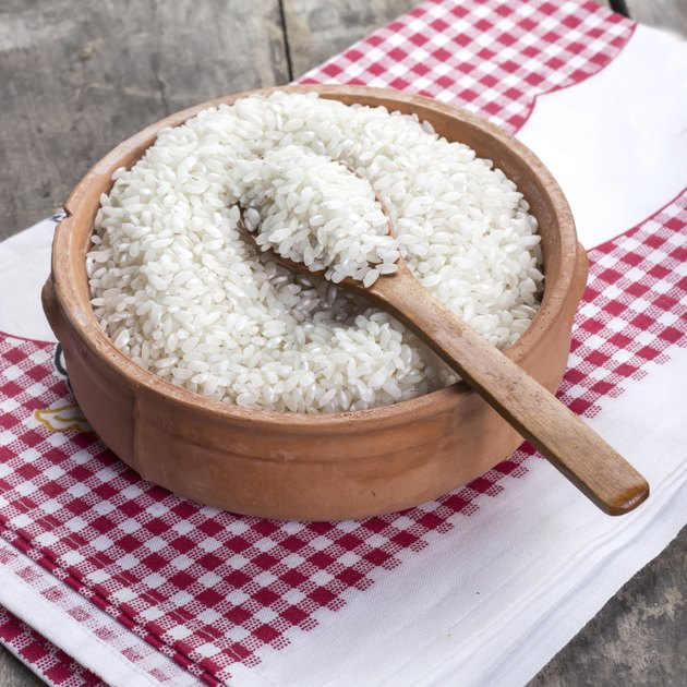 rice on wooden spoon
