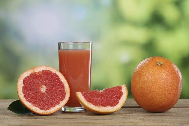 Grapefruit juice and fresh grapefruits in summer
