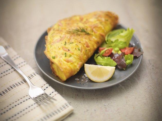 Omelet with Scottish smoked salmon, salad and lemon slice