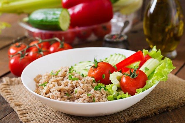 Porridge with fresh vegetables and lettuce. Healthy breakfast