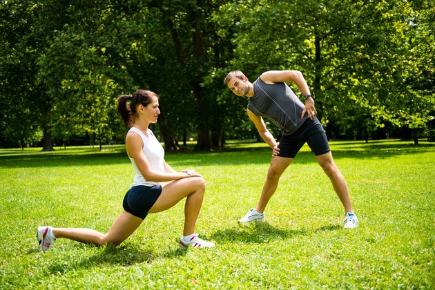 Warm up - couple exercising before jogging