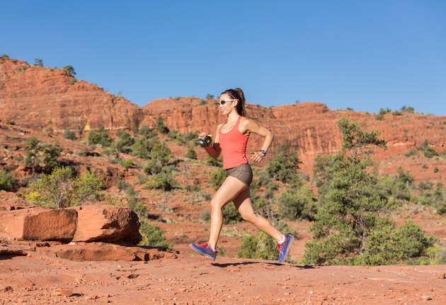 Woman Running Outdoors Uphill