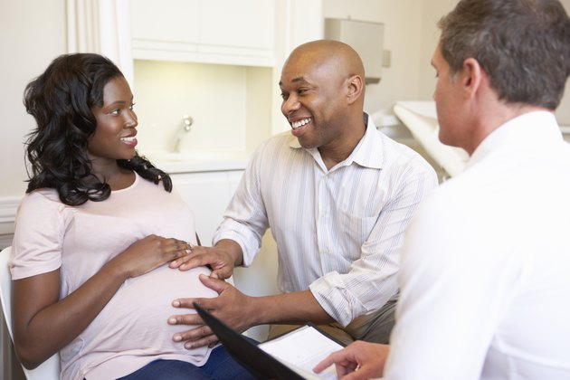 Couple Meeting With Obstetrician In Clinic