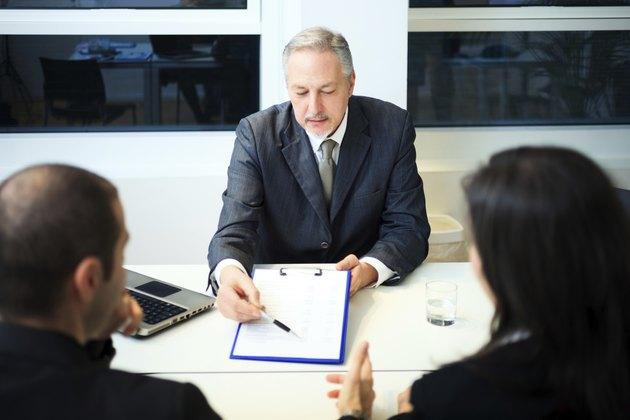 Businessman showing a document