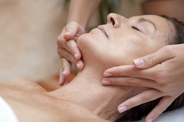 Mature woman receiving massage, eyes closed, close-up