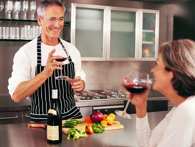 Mature Couple Drinking Wine in Their Kitchen