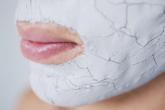 Close-up of a human face applying a facial mask