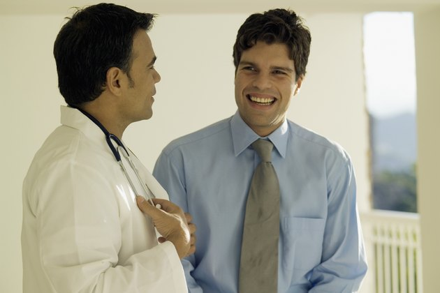 Businessman talking to a male doctor
