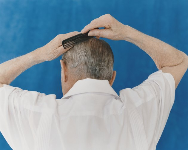 Rear View of a Senior Man Combing His Hair