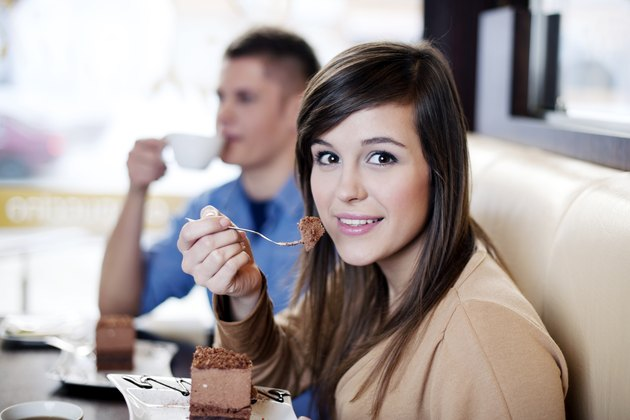 Young woman eating chocolate cake