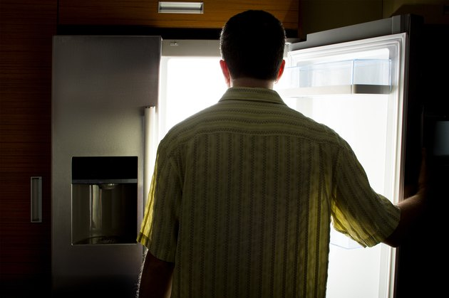 Bachelor Looking For Food in a Fridge