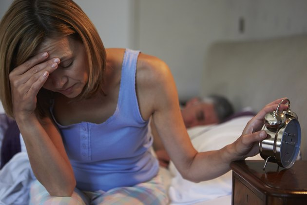Woman Awake In Bed Suffering With Insomnia