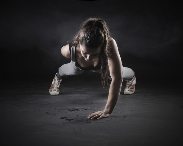 Black and white image of a woman doing pushups
