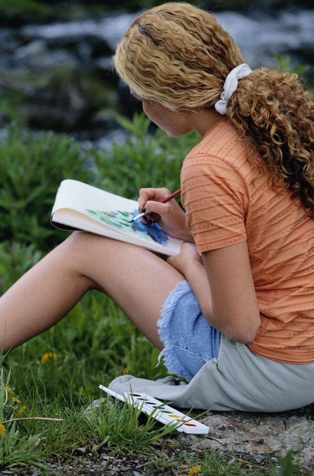 Teen Girl Painting in Notepad