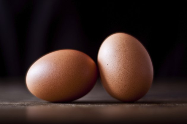 Two eggs on wooden table