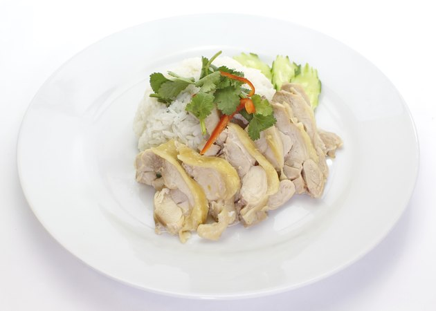hainanese food chicken steamed rice and vegetables