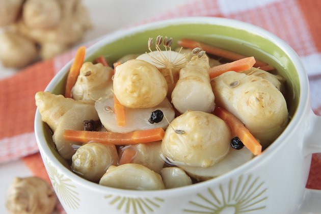 Marinated Jerusalem artichokes in bowl