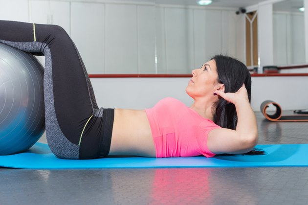 Young woman doing crunches  the gym