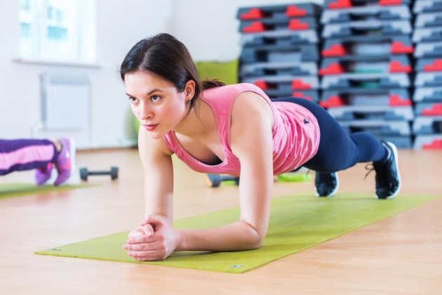A woman performing a forearm plank