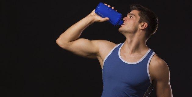 Muscular man drinking protein shake