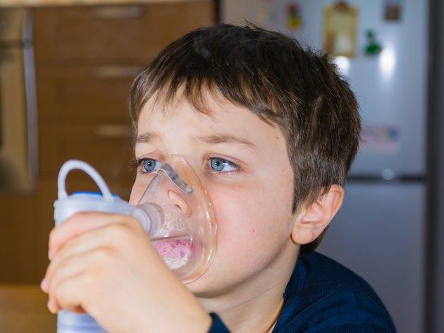 child with inhaler mask