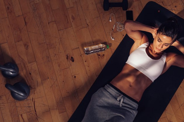 Fitness woman doing abs workout at the gym