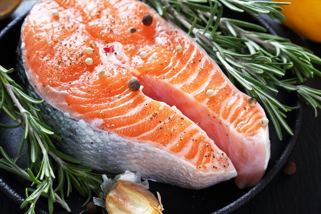 Salmon with rosemary in pan
