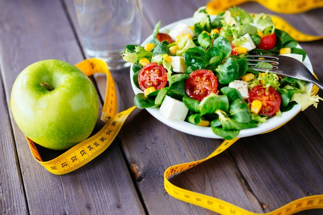 Healthy fitness green salad and apple
