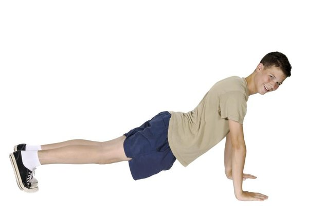 Young man in pushup position isolated with white background
