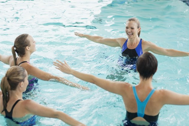 Women taking water aerobics class