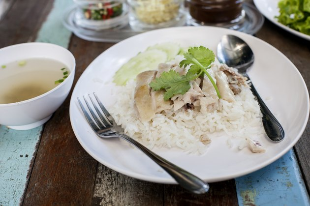 Thai food gourmet steamed chicken with rice ,in wood background.