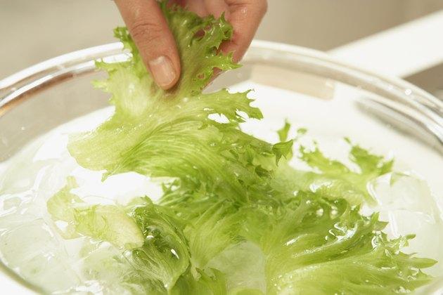 Woman making salad, close up