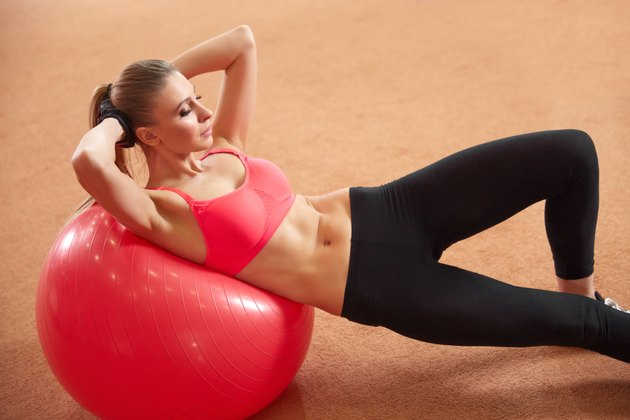 Fitness Woman Exercising on Fitness ball