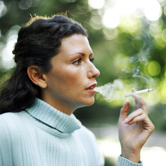 portrait of a young woman smoking a cigarette