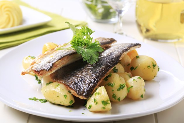 Pan fried trout fillets with potatoes - still life