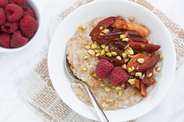 oatmeal with baked fruit for breakfast, closeup, top view