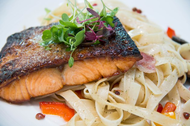pasta with salmon on white  plate