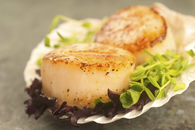 Sea Scallop with greens in a shell