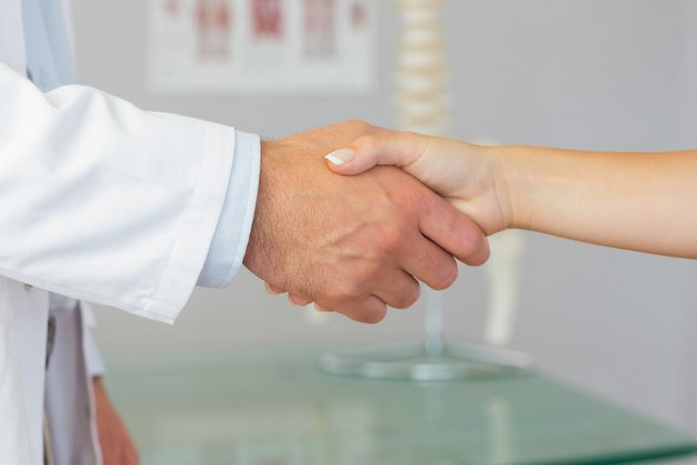 Close up of patient shaking hands with doctor