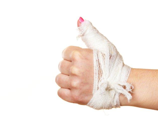 Hand tied elastic bandage on a white background