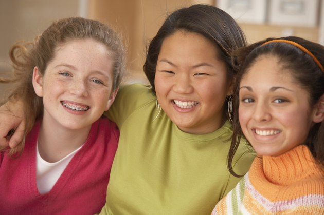 Portrait of three teenage girls smiling