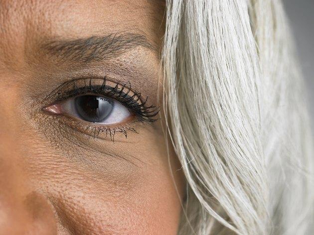 Mature woman, portrait, close-up of left eye